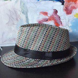 Colorful fedora hat with black satin ribbon trim.